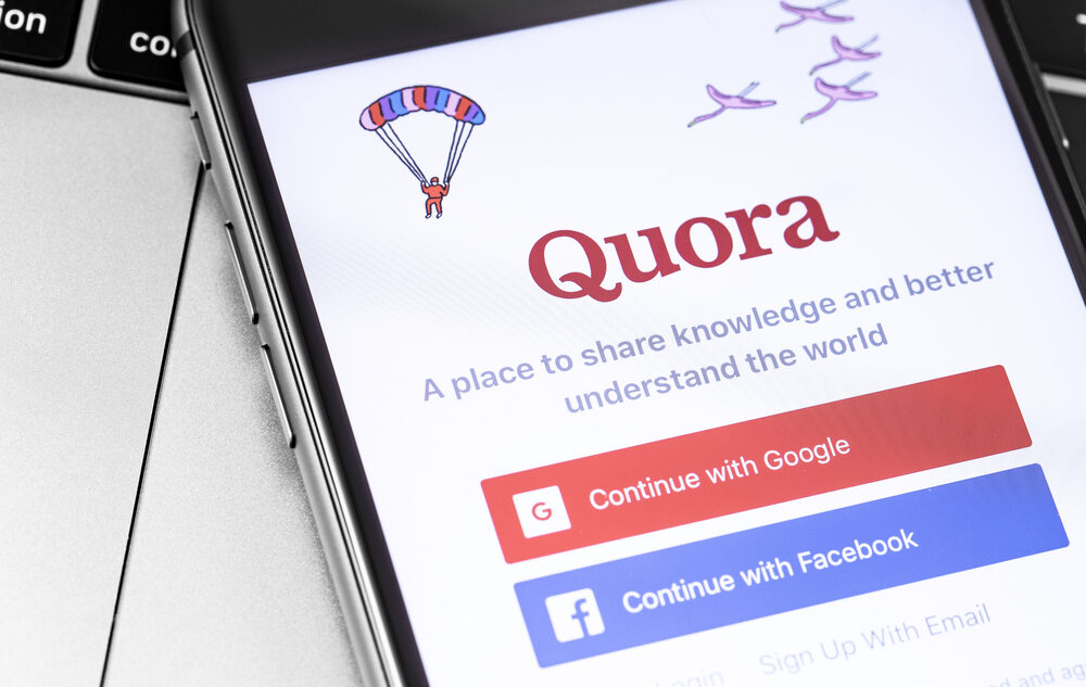 A mobile phone screen showing the Quora log in page, the logo is red.