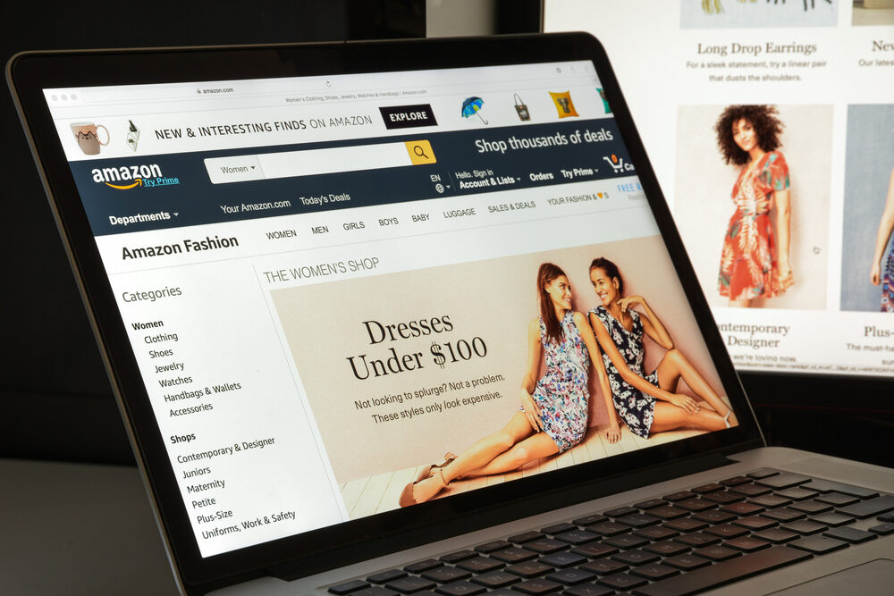 A close up of a laptop screen showing the amazon home page with a selection of products to buy.