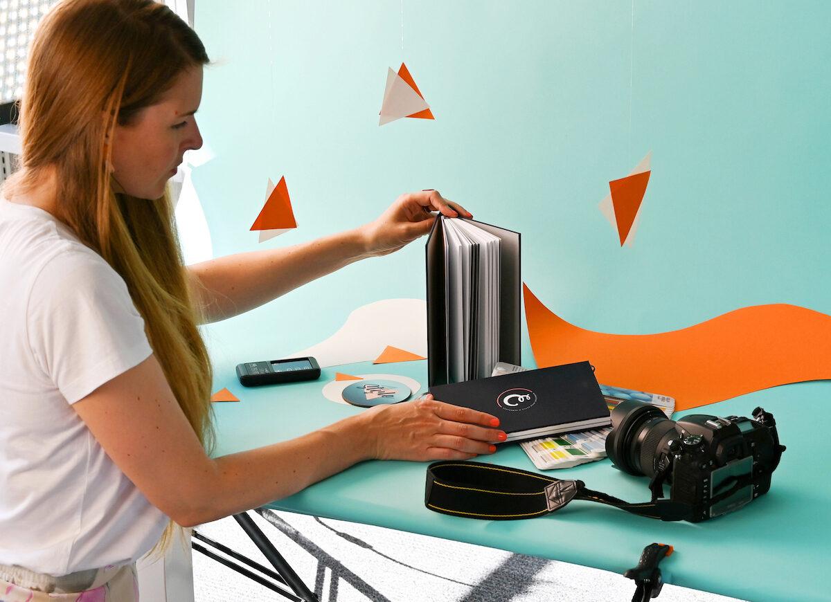 Our Motion and Digital Designer, Mel, arranging a photography shoot.