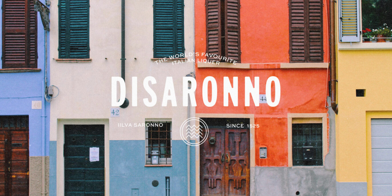 An image of a colourful Italian building with the new Disaronno font overlaid on it.