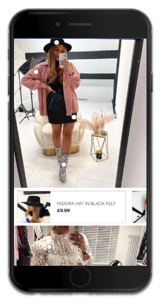 A phone screen with a young woman wearing a pink shit, a black dress, a black hat and snakeskin ankle boots.